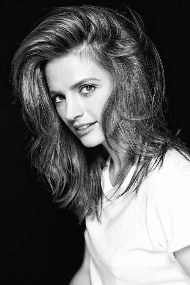 "Stana Katic currently plays the lead role of Emily Byrne in ""Absentia,"" streaming on Amazon. It's a thriller-drama produced by Sony Pictures Television. Upon debut it was one of Amazon's top-ten most popular programs. Stana's feature film work includes: ""The Possession of Hannah Grace,"" ""CBGB,"" ""Big Sur,"" ""The Spirit,"" ""Feast of Love,"" ""The Double"" and Bond franchise installment ""Quantum of Solace."" For 8 seasons, Stana stared as Kate Beckett on ""Castle."" The ABC hit series brought in over 10 million viewers weekly and is in the top five syndicated series in Spain, France, the UK, Italy, and Germany. Stana has ten award nominations and seven wins — including three People's Choice Awards, a PRISM Award, and three TV Guide Awards. Stana is also dedicated to philanthropic projects with a focus on the Environment and on Children's Education and Healthcare. This work has kept her involved with organizations from around the globe. Stana currently resides in Los Angeles."